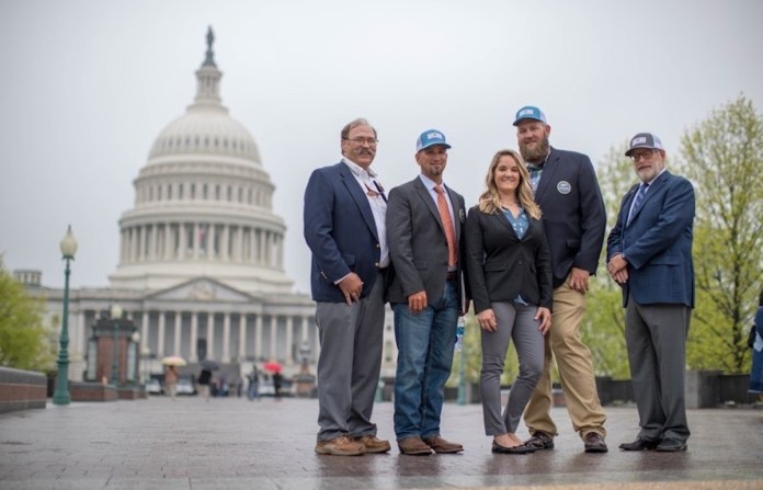 'Fix the water, protect the habitat and pass on a pristine Florida Keys to future generations' - A group of people standing in front of a building - United States Capitol