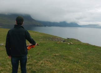 Listen to fiddler prodigy Connor Civatte at weekend's Celtic Festival - A man standing next to a body of water - Fjord