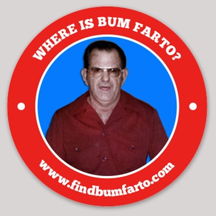 Bum Farto podcast explores Key West's drug-dealing, fugitive fire chief - A person holding a sign - Notre Dame of Trece Martires