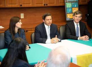 Gov. Ron DeSantis speaks after a public health emergency is announced in the state. DeSantis is pictured alongside Lt. Gov. Jeanette Nunez and Florida's Surgeon General, Scott Rivkees.
