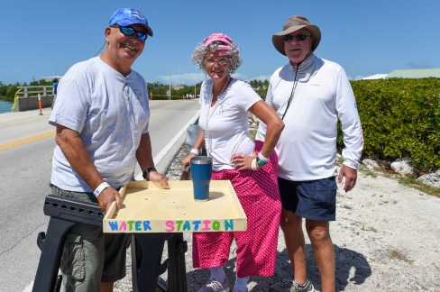 """""""We don't want 'em droppin' from heat stroke."""" Mike Viveiros, left, Mildred Shrunk and Skip Baily staff the midway water station."""