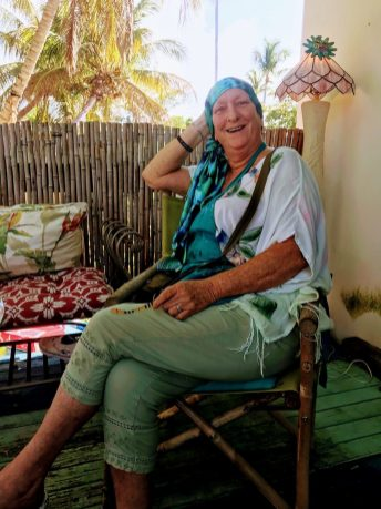 Maxine Trainer rests at her home in Islamorada before a chemotherapy treatment at Mariners Hospital. CONTRIBUTED