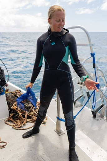 After divers haul up any debris they find on the reefs, Cortney Benson sorts, weighs and records what they find. TIFFANY DUONG/Keys Weekly