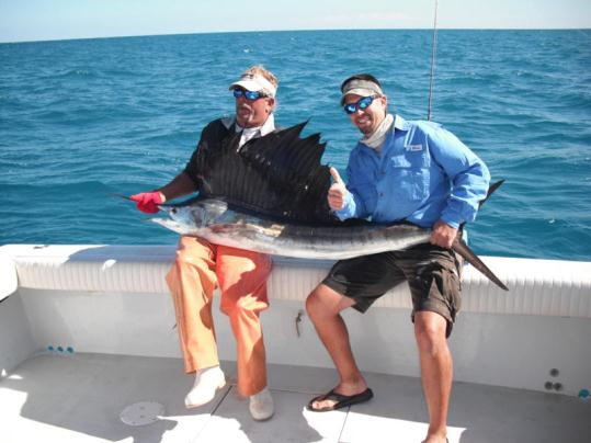 Ryan Yancey with his first sailfish caught this past week aboard the Best Bet. Pictured with Best Bet First Mate Bobby Manske