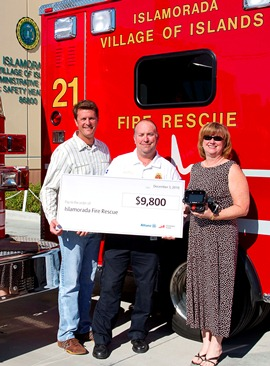 L-R) Joe Roth of Regan Insurance, Assistant Fire Chief Terry Abel and Jody Martin of Fireman's Fund Insurance Company
