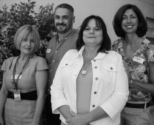 Pictured from left to right: LuAnn Diaz, Attorney Tom Hampton, Alexsa Leto, and Michelle Coldiron