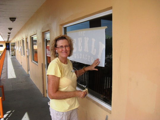 Renee Anderson is behind the snazzy new window lettering at The Weekly Newspapers headquarters
