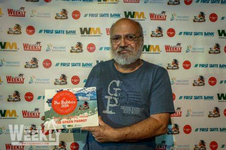 A man holding a sign - Key West