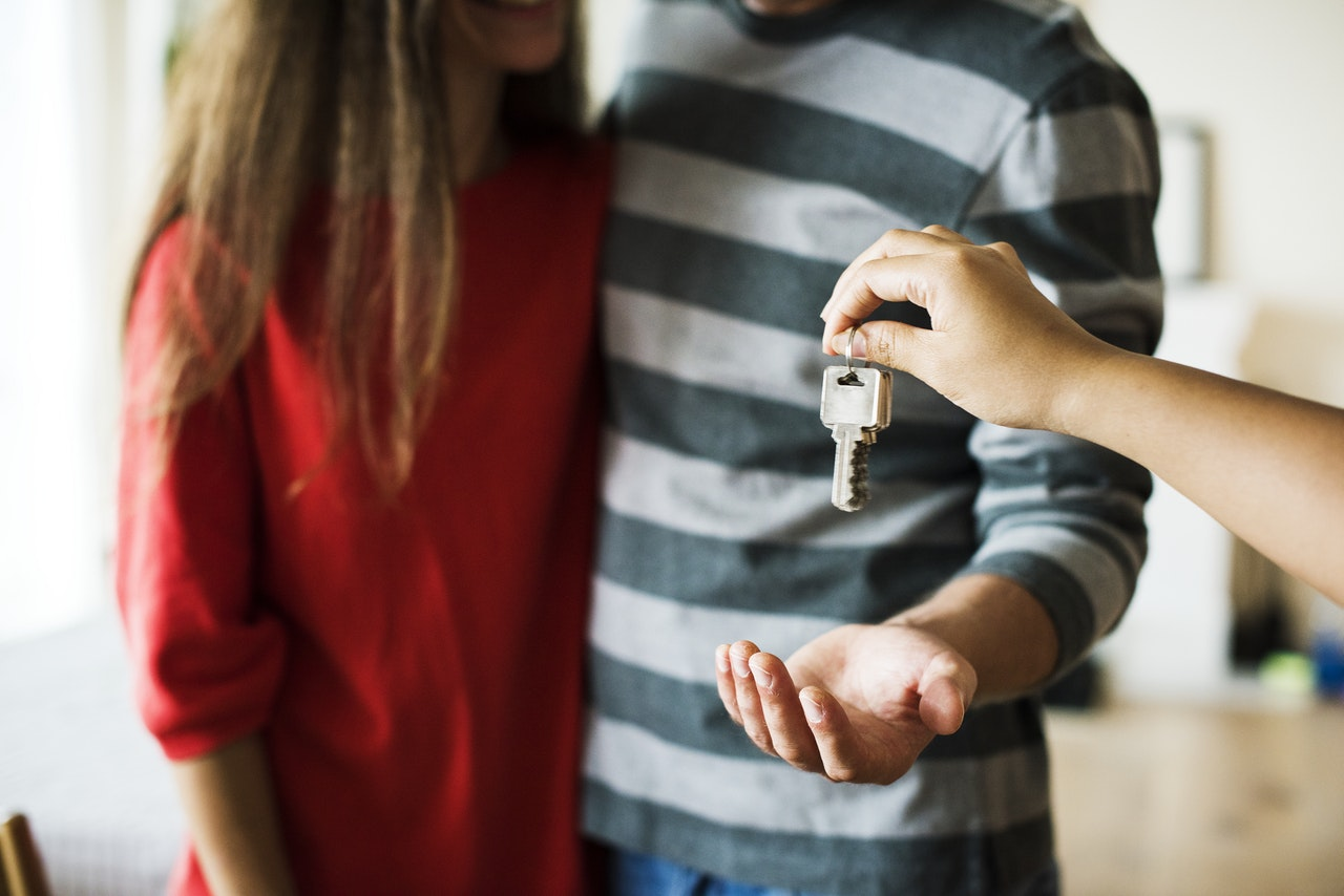 a couple receiving keys