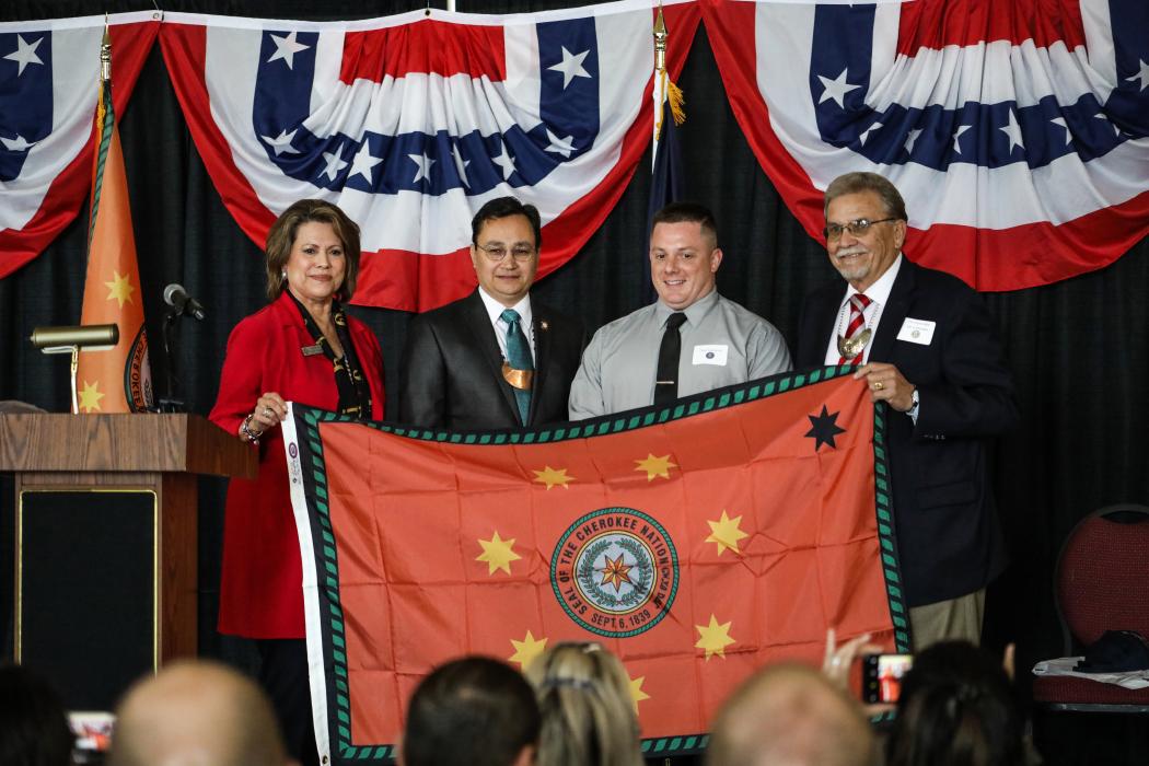 Flag presentation for USNS Cherokee Nation