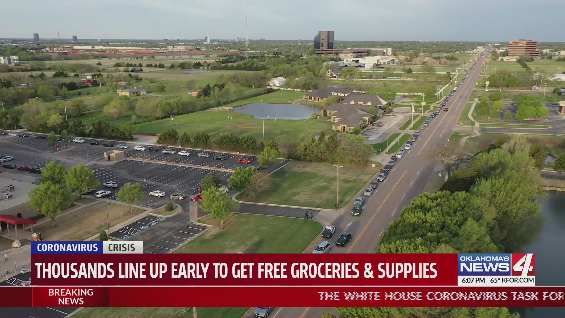 cars for miles lined up for free groceries