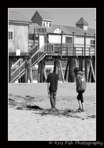 This young couple is enjoying a walk on the beach near The Pier