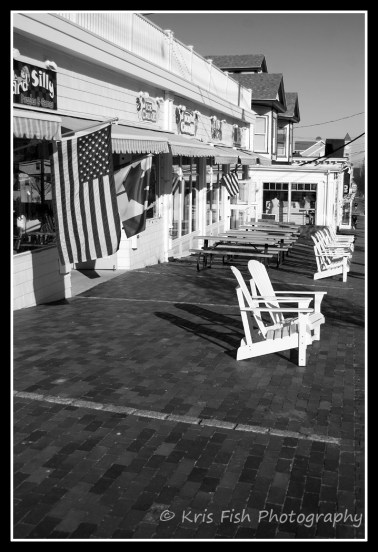 U.S. and Canadian flags fly proudly in front of Dickinson's Candy Factory, showing OOB's reliance on Canadian tourism.