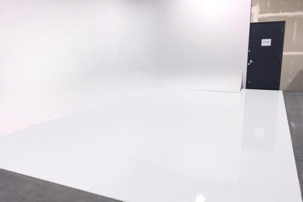 white epoxy floor photo studio