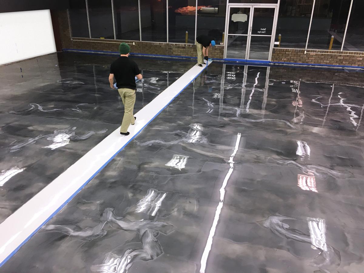An overhead view of a titanium gray & white metallic epoxy floor
