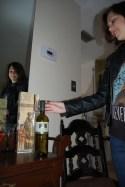 King reaches for a bottle of Chiara, an Italian wine.