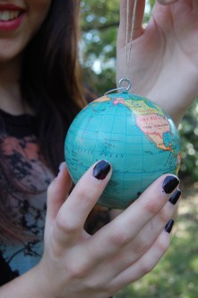 King points out Hawaii on her globe.