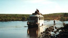 Crossing a flooded river in the Kimberley, Australia