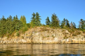 Rocky cliff where kids jump into the water