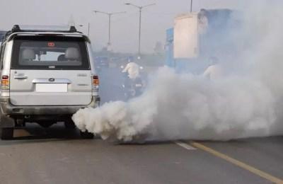 Peshawar, vehicles, smoke emitting