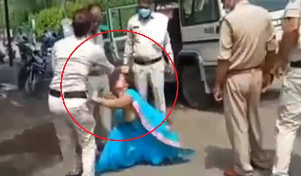 Woman India mask, Madhya Pradesh, police, Indian police beat woman