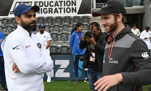 New Zealand captain Kane Williamson (R) talks to India captain Virat Kohli after New Zealand won the Test series on day three of the second Test cricket match between New Zealand and India at the Hagley Oval in Christchurch on March 2, 2020. (Photo by PETER PARKS / AFP)