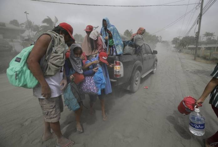 taal volcano people leave home philippines photos
