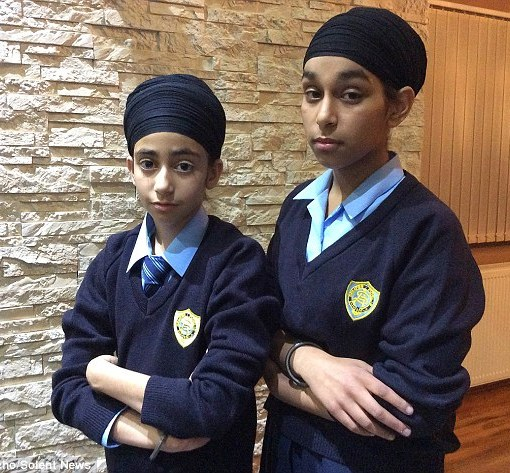 Simranjot Kaur, 13, (right) and 11-year-old Prasimran Kaur, (left) who aren't related, returned to St Anne's Catholic School in Southampton, Hampshire, wearing their traditional religious headwear yesterday