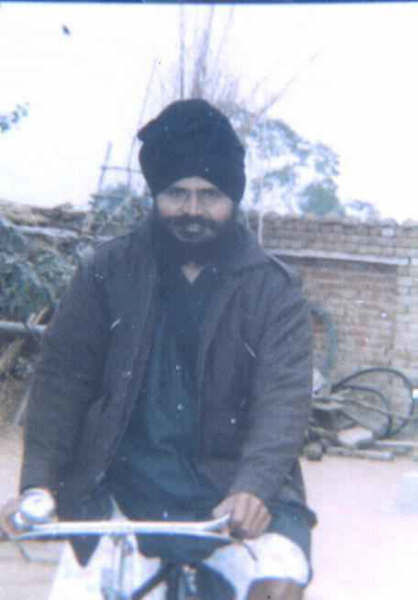 Baba Manochahal riding on a bicycle