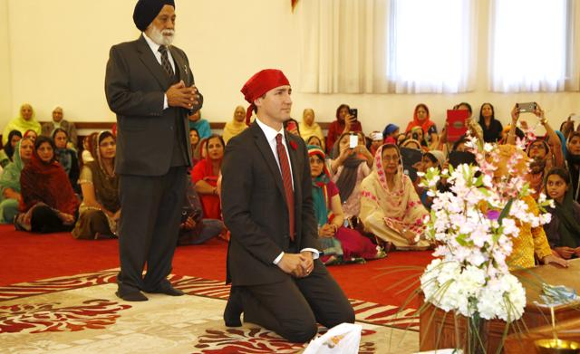 Canadian Prime Minister Justin Trudeau kneels as he arrives at the Gurdwara Sahib Ottawa Sikh Society in Ottawa, Canada. PHOTO: REUTERS