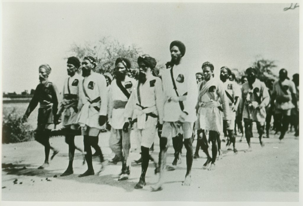Volunteers marching resolutely to court arrest during the Guru ka Bagh protest. Photo courtesy Panjab Digital Library Guru ka Bagh Morcha