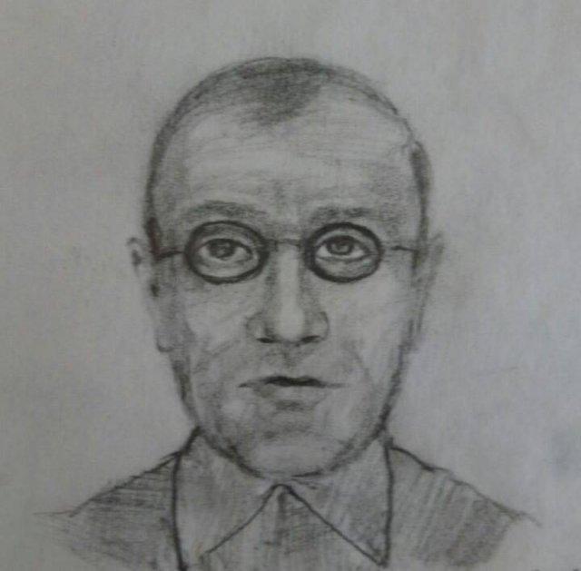 Полиция устанавливает личность подозреваемого в совершении разбойного нападения