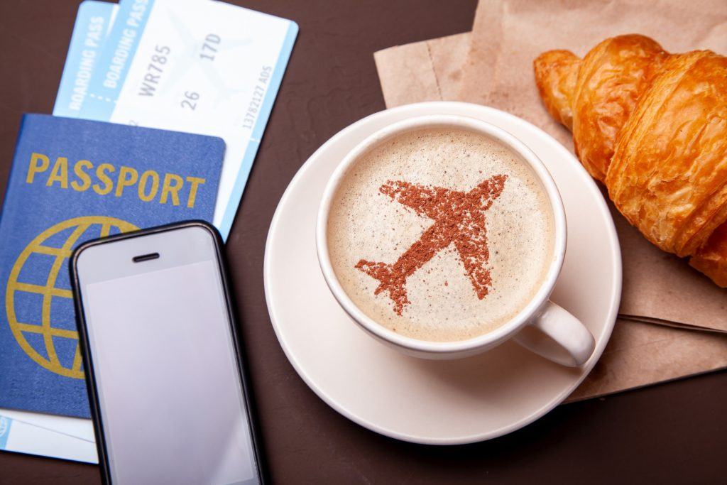 Image of coffee with airplane in the foam