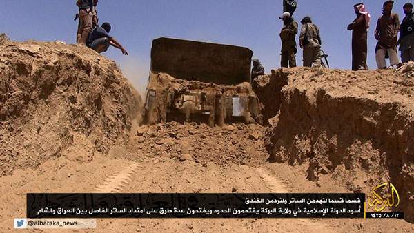 ISIS' bulldozer destroying a section of the Iraq-Syria border, June 2014 (Image: New York Review of Books)