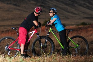 A couple taking a break while on their KHS Fitness bicycles