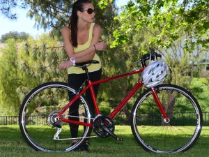 A rider taking a break after riding her KHS Vitamin bicycle