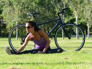 A rider stretching after riding her KHS Vitamin bicycle