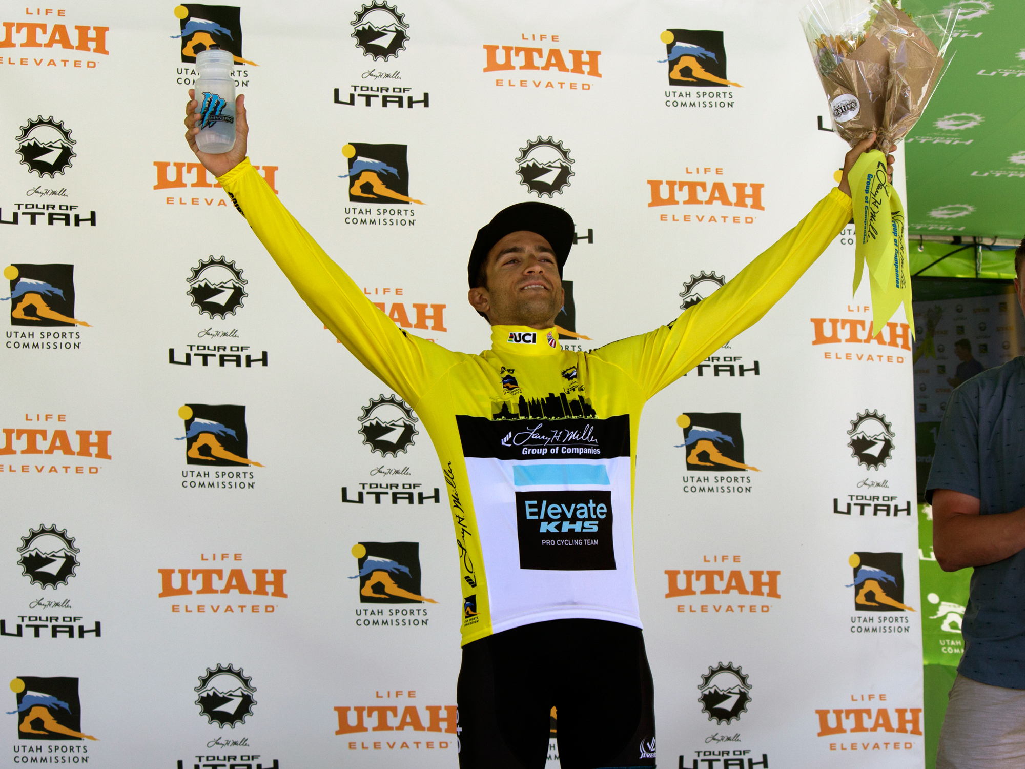 Elevate KHS Team Racer wearing the Yellow Jersey on the podium