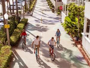 KHS, models riding bikes on boardwalk.