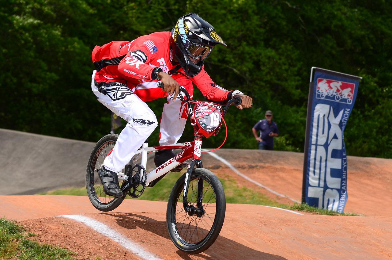 Free Agent BMX racer Alec Bob racing over a jump