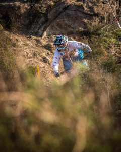 KHS pro mtb team rider Nik Nestoroff riding on a trail.