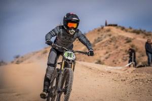 KHS pro mtb team rider Kailey Skelton riding down a trail.