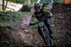 KHS Pro MTB team rider Steven Walton warming up on the trail for DH finals.