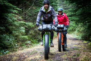 Riders on KHS 4 Season bicycles on a forest trail