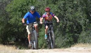 A couple enjoying the fresh air on KHS Fat Tire bikes
