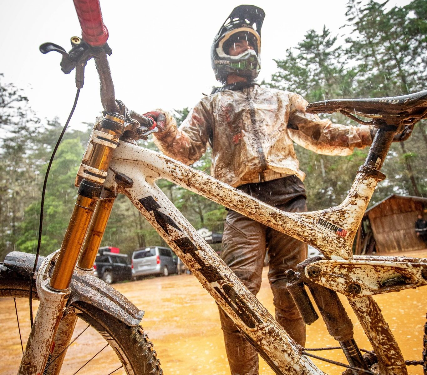 KHS Pro MTB rider Nik Nestoroff taking a breath after a practice run in the Costa Rican mudd.