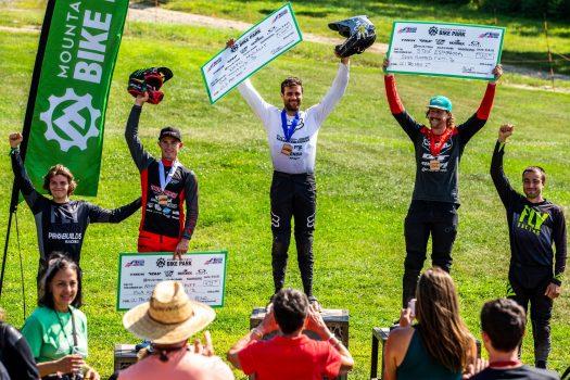 KHS pro MTB rider Nik Nestoroff standing in third place at Mountain Creek Resort.