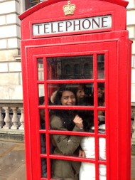 6 girls in a phone booth