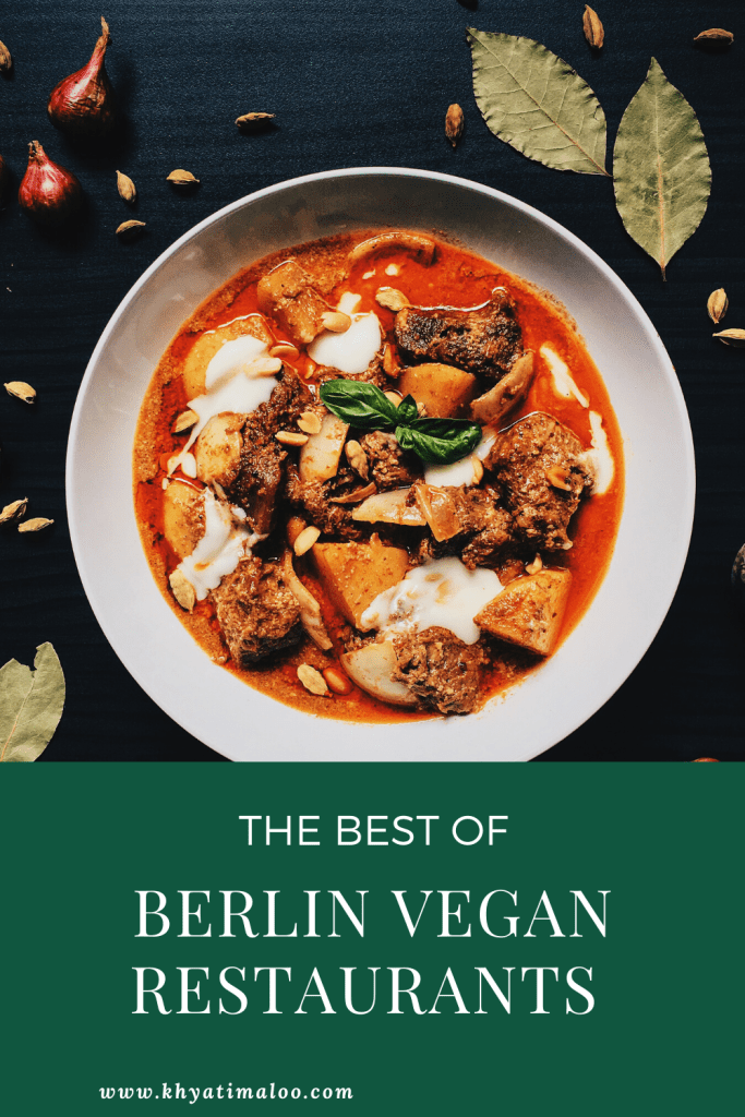 Vegan curry in a bowl. With text that reads Berlin Vegan Guide