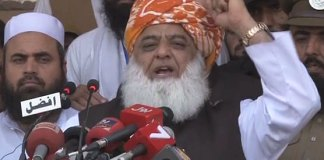 Maulana Fazlur Rehman addressing conference